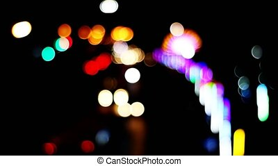 blur and bokeh of vehicle on the road night light of market fair