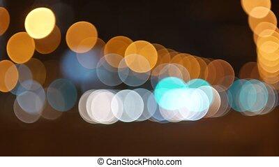 blur background. Moving bokeh circles of night traffic. Defocused night traffic lights at Ratchaprasong Intersection Bangkok, Thailand. Moving particles. Colorful, blurred, bokeh lights background.