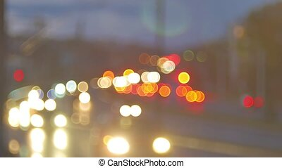 blur background. Moving bokeh circles of night traffic. Defocused night traffic lights at any night city. Moving particles. Colorful, blurred, bokeh lights background.