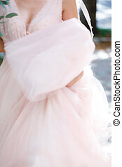 blur background of Hands of the bride on a wedding dress