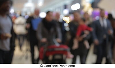 Blur background of shopping mall and crowd of walking people in the shopping mall center with bokeh