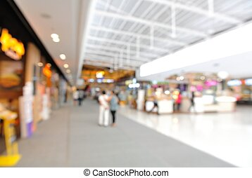 Blur background with bokeh light of Department store