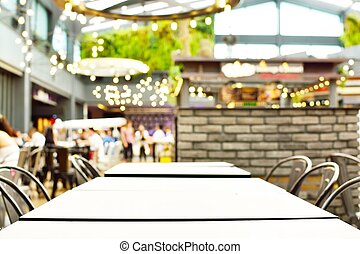 blur background with bokeh light of empty Table in coffee shop