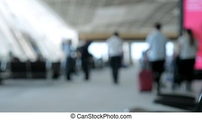 Blur background with walking people in airport.