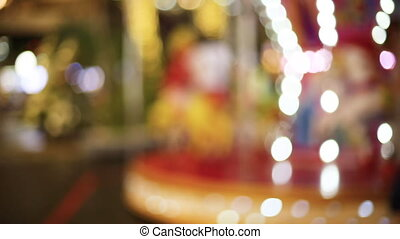 Blur dreamy Carousel and bokeh of light. - Blur dreamy...