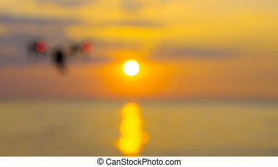 Blur for professional camera drone flying on sea.