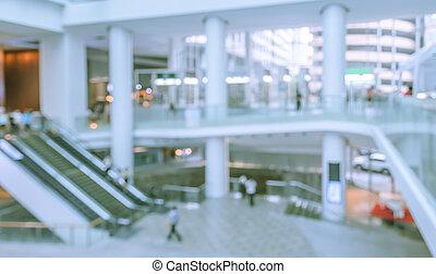 Blur image of escalators at the modern shopping mall