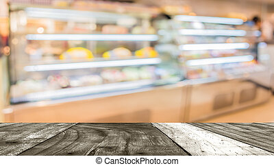 Blur image of people in bakery shop for background usage