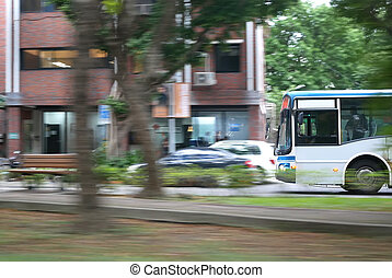 Blur motion of bus driving on road during rush hour