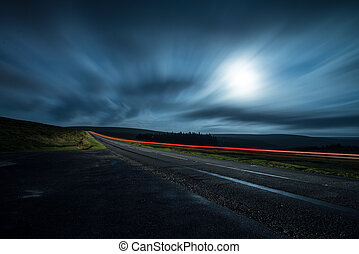Blur night shoot of fast driving car - blur night shoot of...