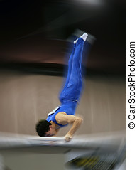 Blur of a gymnast - Motion blur of a gymnast competing on...