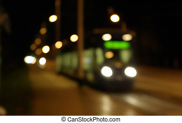 blur of a tram in zagreb on an empty street at night