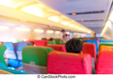 blur of Airplane seat with in cabin of huge aircraft.