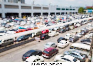 Blur of car at public car parking