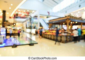 Blur of Defocus Background of People Walking in Supermarket...