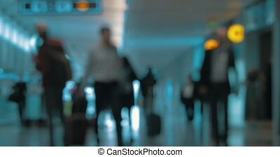 Blur of passengers traffic in airport hall - People with...