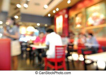 Blur or Defocus Background of People eating in Restaurant or...