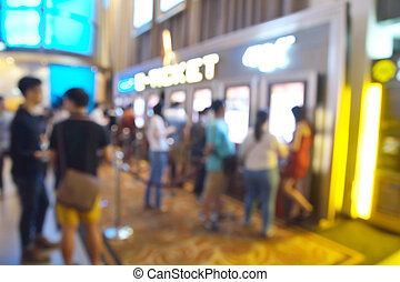 Blur or Defocus image of People line up to buy Movie Ticket...