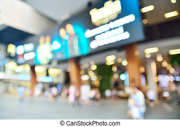 Blur or Defocus image of People Walking in the City Shopping Street