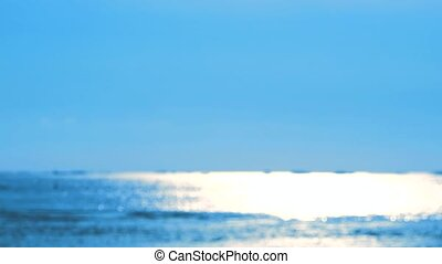 blur reflection of sun light on sea surface and little wave move