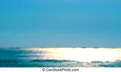 blur reflection of sun light on sea surface and little wave moving