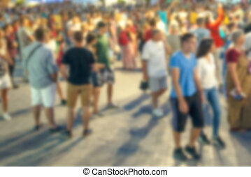 Blur street crowd in summer evening