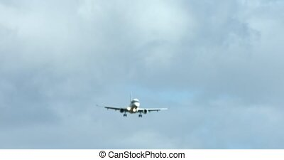 Blured view on airplane flying on sky, upper head. The plane is lading. Background concept.