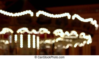 Blured carousel is moving. Motion background.