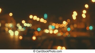 Blured traffic in night city street toned in warm holiday...