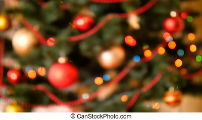 Blurred 4k footage of decorated Christmas tree and colorful lights