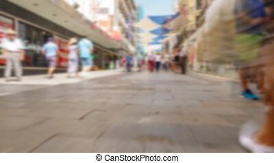 Blurred 4k image of tourist walking along preciados street -...