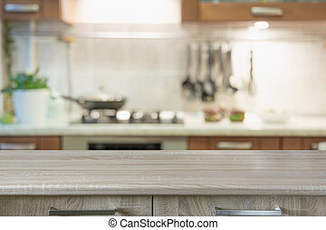Blurred abstract background. Modern kitchen with tabletop and space for display or montage your products.