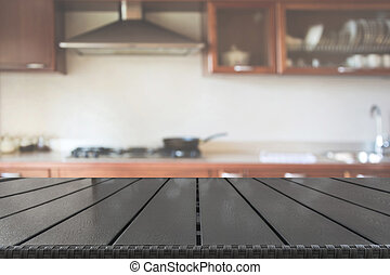Blurred background. Modern defocused kitchen with wooden tabletop as background for display or montage your products.