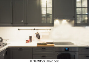 Blurred abstract background. Modern pastel grey kitchen interior for background. Indoors.