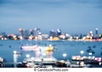 Blurred abstract background of office building at sea harbour at evening time, urban life.
