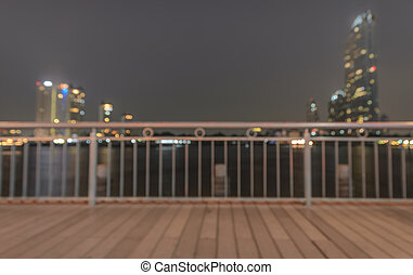 Blurred abstract background of riverwalk with cityscape