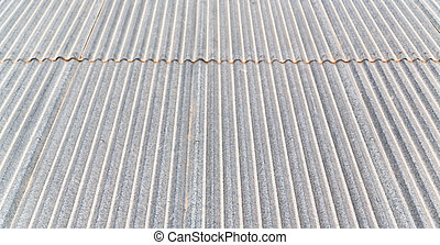 background texture of a corrugated metal roof