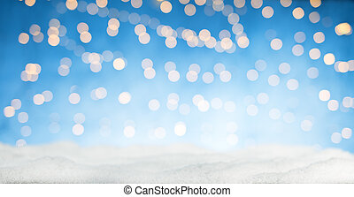Blurred abstract golden spot lights with snow