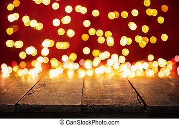 Blurred abstract golden spot lights with wood - Blurred...
