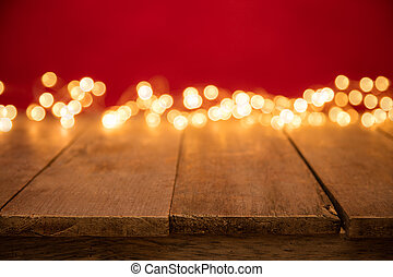 Blurred abstract golden spot lights with wood