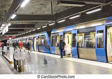 subway - Blurred advancing people at the subway station