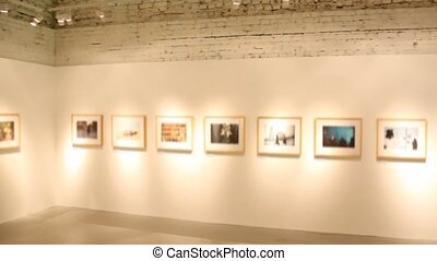 blurred art pictures in exhibition hall, panning