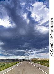 Blurred asphalt road with clouds