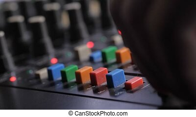 Blurred audio console with indicators and buttons - Closeup...