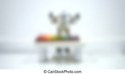 Blurred background. A small robot plays on a xylophone close up. Artificial Intelligence. AI. Smart robot. Concept of 4.0 industrial revolution. Illustrative editorial