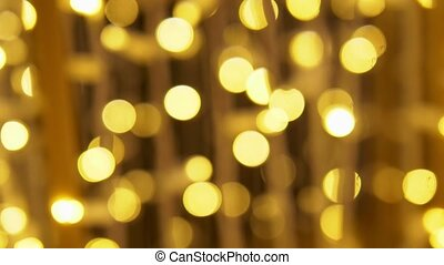 blurred background. copy space. Golden lights garland with blue flares.