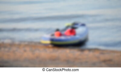 Blurred background. Empty sup boards sway on the sea waves