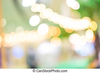 Blurred background : Festival area in shopping mall with bokeh