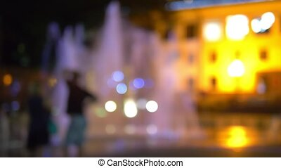 blurred background. fountain illuminated night illumination.