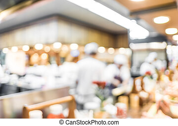 Blurred background : Groups of Chef cooking in the open...
